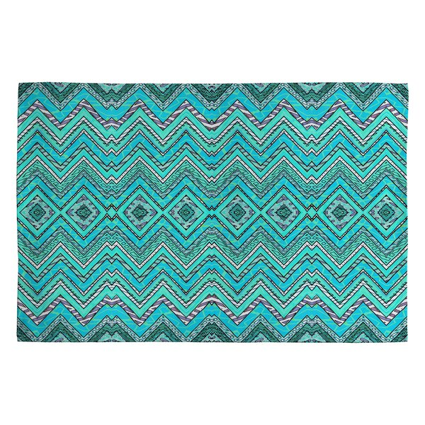 Ingrid Padilla Turquoise Area Rug by Deny Designs
