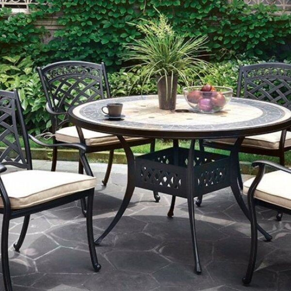 Coury Aluminum Dining Table by Fleur De Lis Living