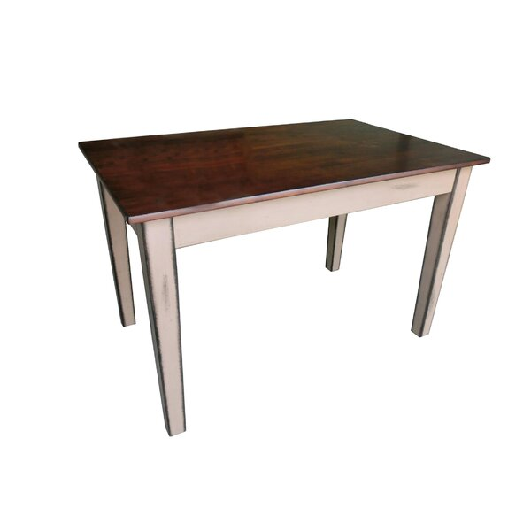 Adalberto Solid Wood Dining Table by August Grove