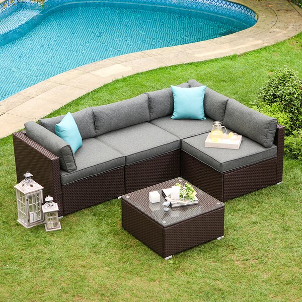 Bavorov 5-Piece Outdoor Furniture Chocolate Brown Wicker Sofa W Dark Grey Cushions Glass-Top Coffee Table 2 Turquoise Pillows Incl. Waterproof Cover by Wrought Studio