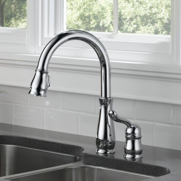 Leland Pull Down Touch Single Handle Kitchen Faucet with MagnaTite® Docking and Diamond Seal Technology by Delta