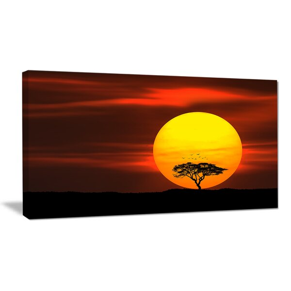 Lonely Tree with Birds at Sunset Photographic Print on Wrapped Canvas by Design Art