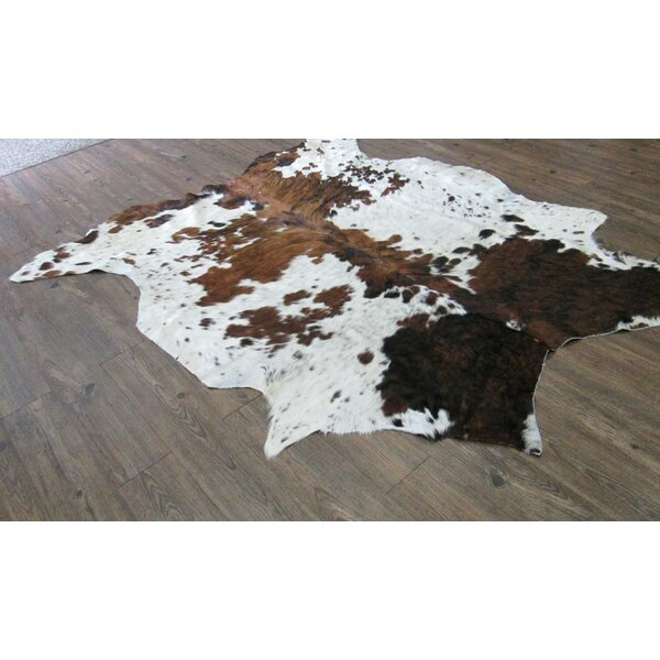 Whitman Hand-Woven Cowhide Brown/White Area Rug by Loon Peak