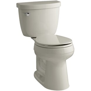 Cimarron Comfort Height Two-Piece Round-Front 1.6 GPF Toilet with Aquapiston Flush Technology and Left-Hand Trip Lever ByKohler