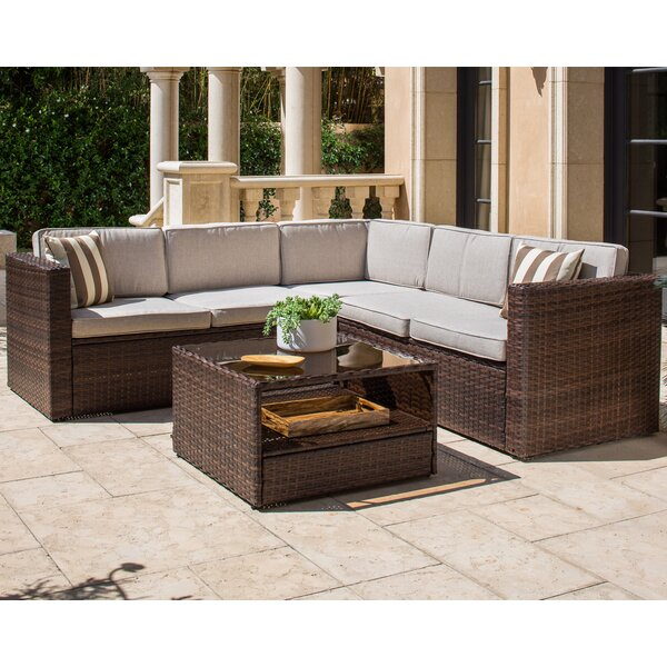 Outdoor 4 Piece Rattan Sectional Seating Group with Cushions by SOLAURA