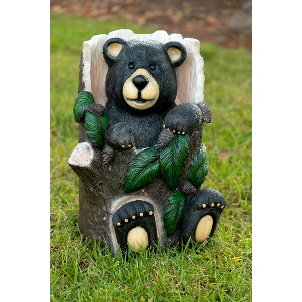 Raycliff Bear Sitting in Tree Trunk Statue by Millwood Pines