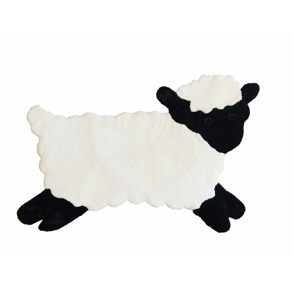 Howery Lamb Faux Sheepskin Hand-Woven White/Black Area Rug by Zoomie Kids