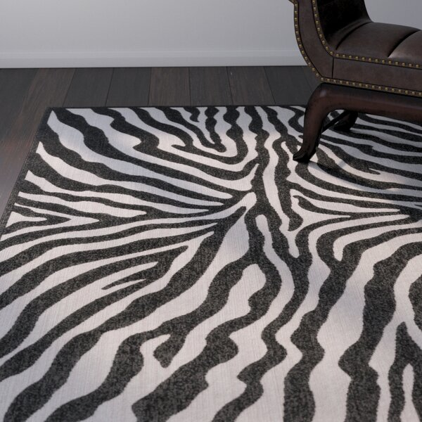 Dalton Black/Ivory Indoor/Outdoor Area Rug by World Menagerie