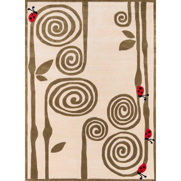 Sellars Animal Print Handmade Tufted Ivory Area Rug
