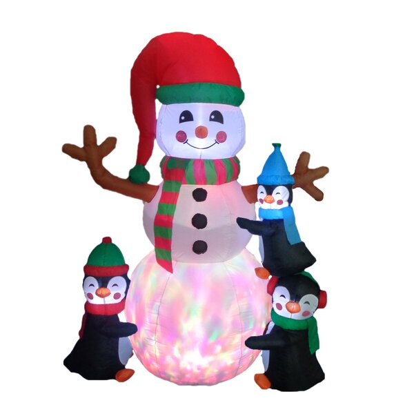 Christmas Inflatable Penguins Building Snowman by