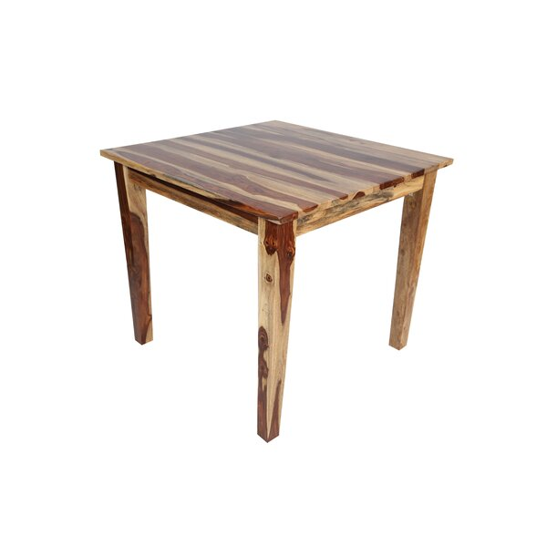 Traci Solid Wood Dining Table by Loon Peak