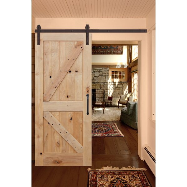 Rustic Knotty Alder Unfinished K Strap Solid Panelled Wood Interior Barn Door by Creative Entryways