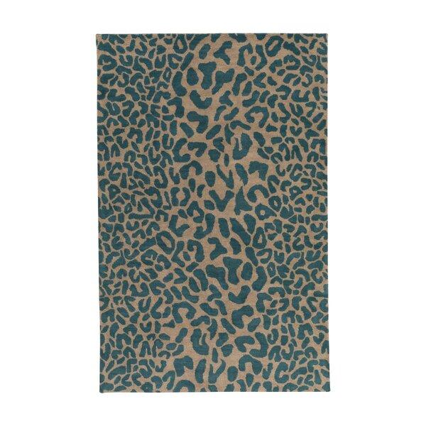 Macias Teal Animal Print Area Rug by Wade Logan