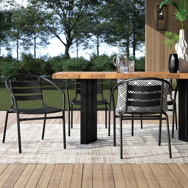 Corrales Stacking Patio Dining Chair (Set Of 4) By Mercury Row by Mercury Row Looking for