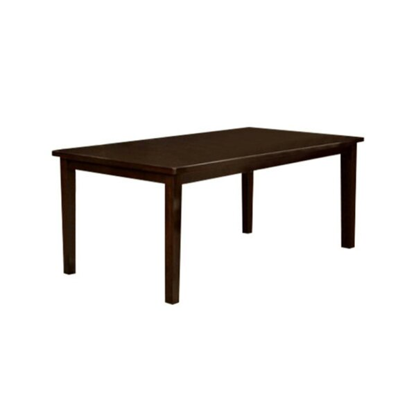 Cuadra Transitional Solid Wood Dining Table by Fleur De Lis Living