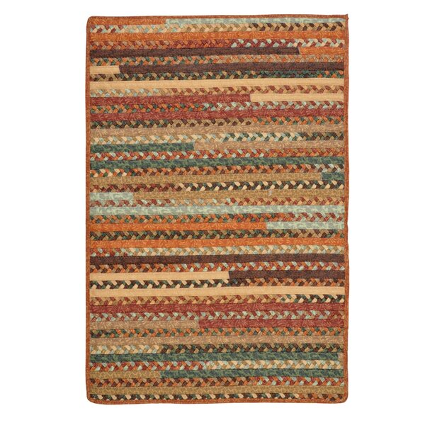 Surette Warm Chestnut Area Rug by August Grove