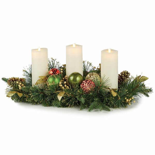 Highland Holiday Candle Centerpiece A festive mix of classic ornaments, pine and golden leaves.