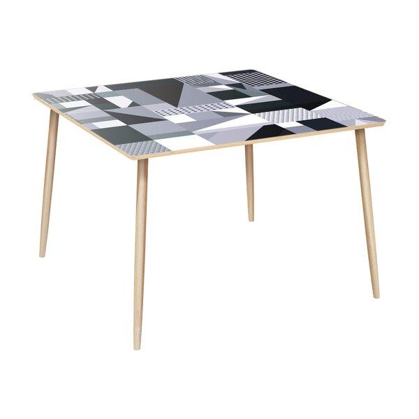 Gamez Dining Table by Orren Ellis