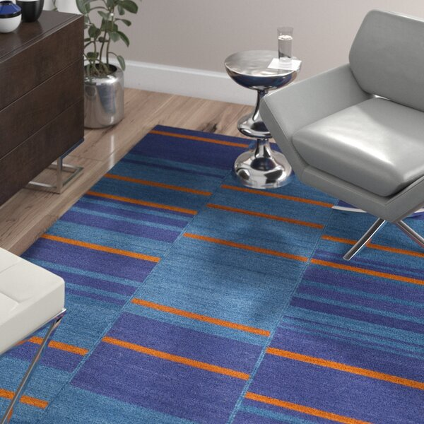 Korina Blue Area Rug by Wade Logan