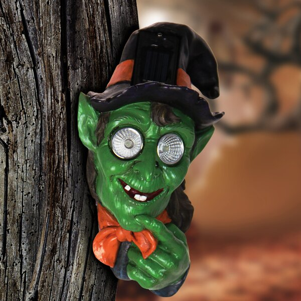 Solar Witch Tree Hugger Figurine by The Holiday Aisle