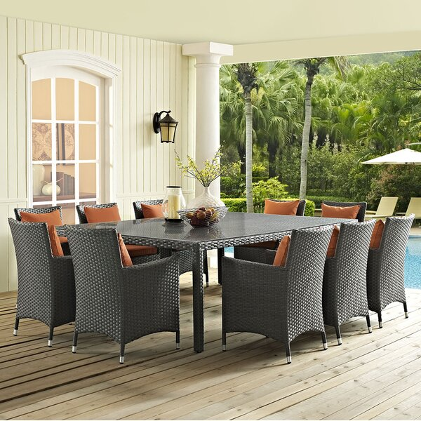 Tripp 11 Piece Dining Set with Sunbrella Cushions by Brayden Studio
