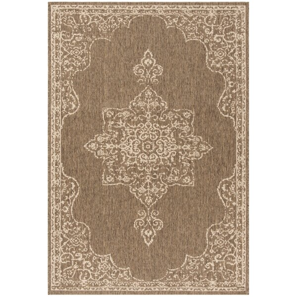 Tomohon Cream/Beige Area Rug by Ophelia & Co.