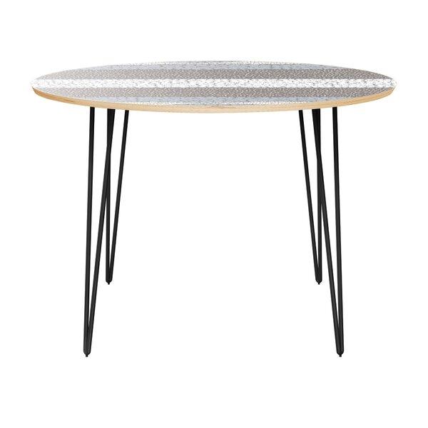 Gagner Dining Table by Orren Ellis