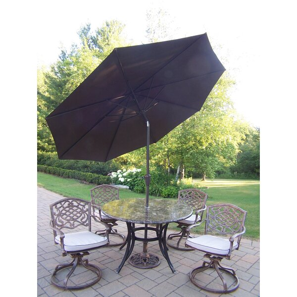 Stone Art Swivel Dining Set with Cushions and Umbrella by Oakland Living