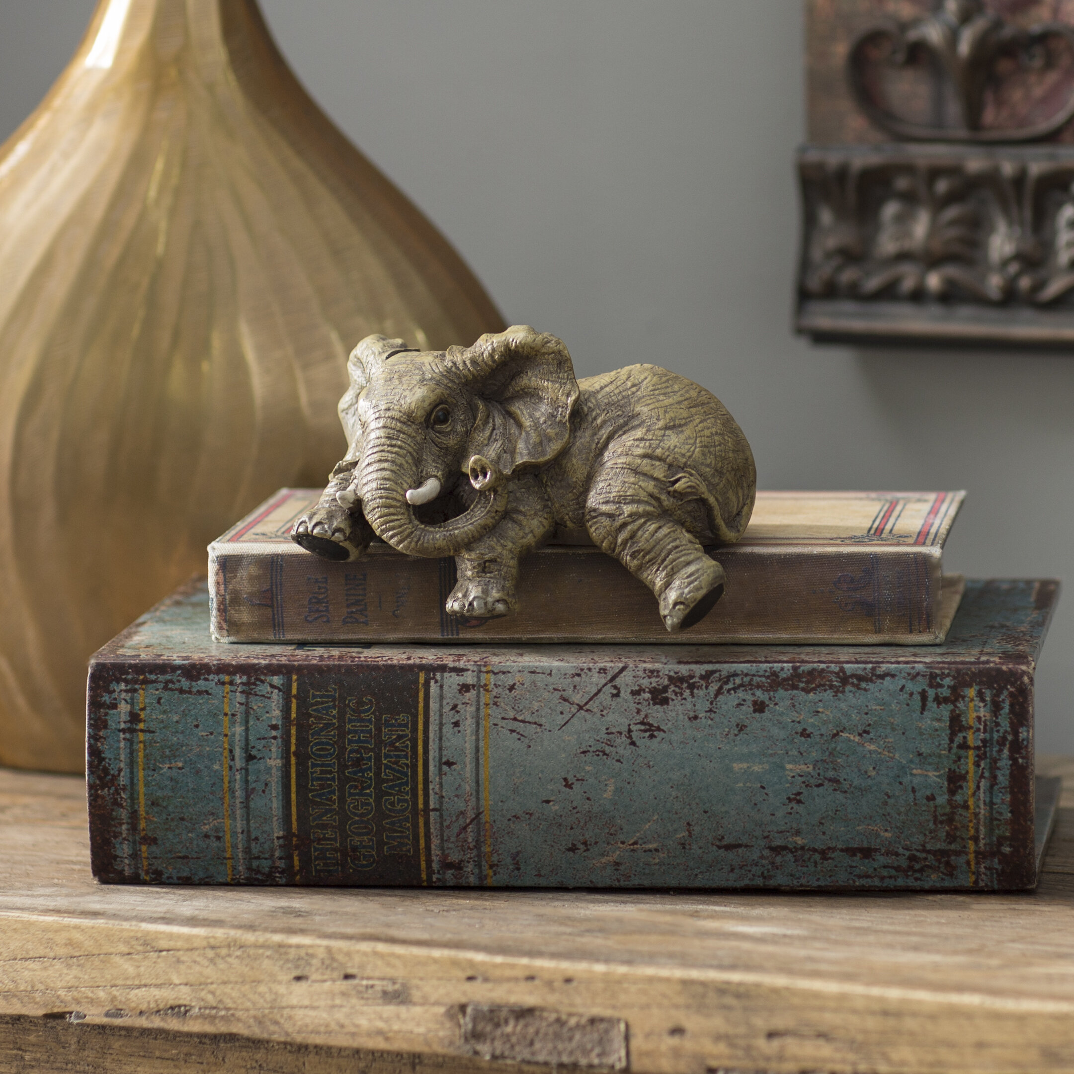 Urban Trends Ceramic Geometric Sitting Cat Head Tilted on The Side Gloss Finish White Figurine