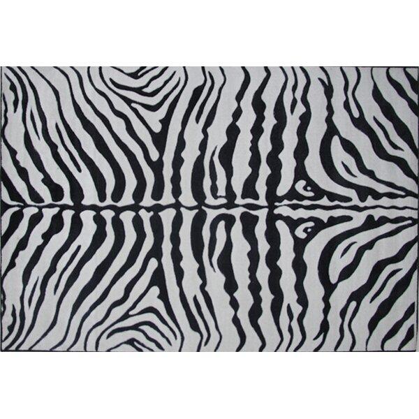 Supreme Zebra Skin Machine Woven Black/White Area Rug by Fun Rugs