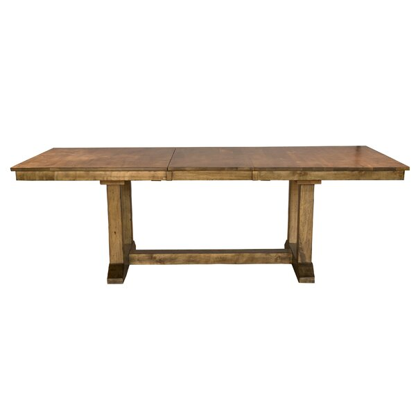Ian Extendable Solid Wood Dining Table by One Allium Way