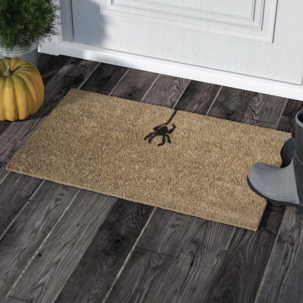 Thomson Spider Handwoven Coconut Fiber Doormat by Andover Mills