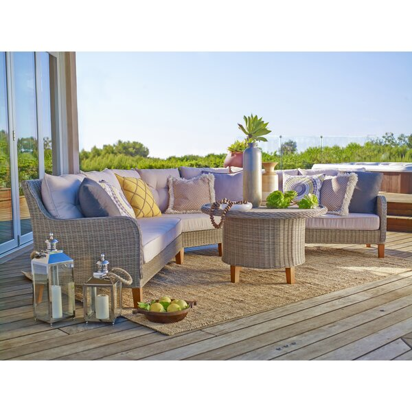 Ferne 4 Piece Rattan Sectional Seating Group with Cushions