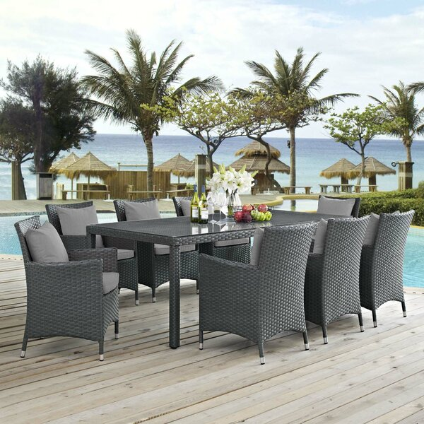 Tripp 9 Piece Dining Set with Sunbrella Cushions by Brayden Studio