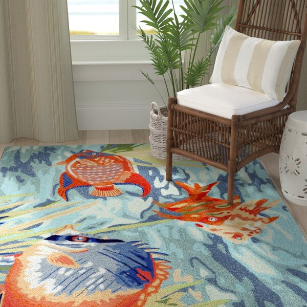 Clowers Tropical Fish Blue Area Rug by Highland Dunes