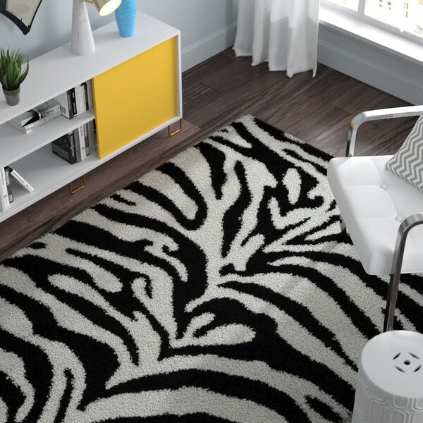 Burns Zebra Print Black/Snow White Shag Area Rug by Zipcode Design