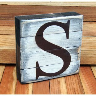 classic letter ampersand on rustic board wall decor