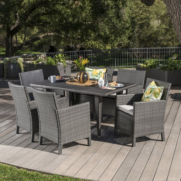 Reidy Outdoor Wicker Rectangular 7 Piece Dining Set with Cushions by Orren Ellis