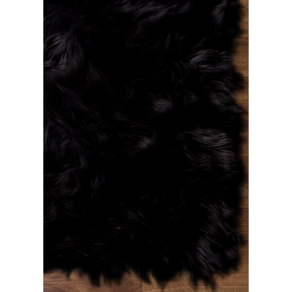 Charlotte Hand-Woven Faux Sheepskin Black Area Rug by House of Hampton