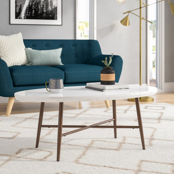 Umstead Oval Engineered Wood Coffee Table by George Oliver