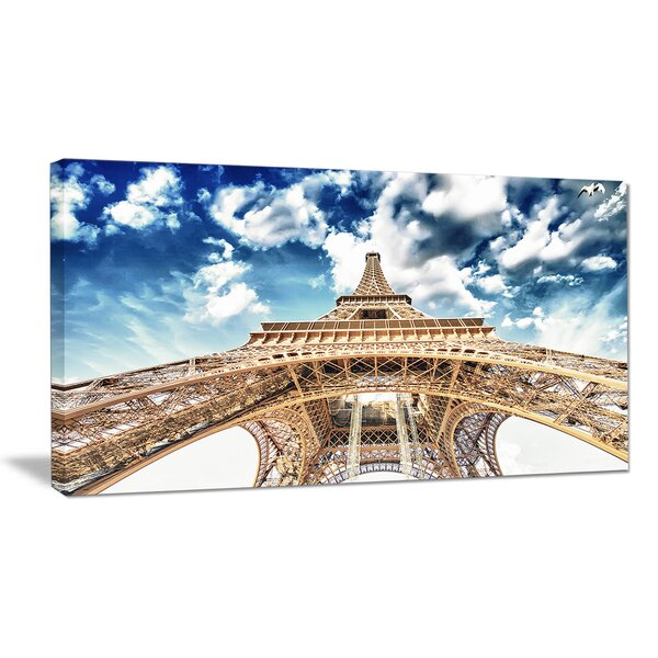 Beautiful View of Paris Eiffel Tower Under Clouds Cityscape Photographic Print on Wrapped Canvas by Design Art