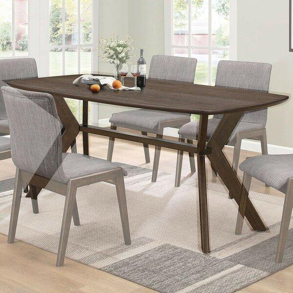 Earnhardt Solid Wood Dining Table by Corrigan Studio