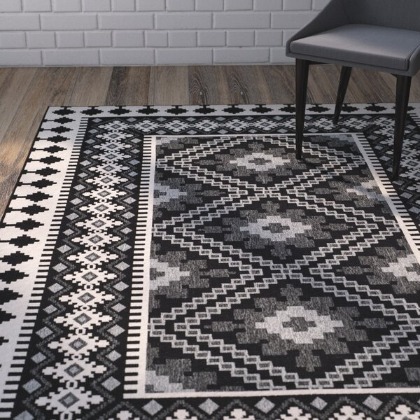 Mannings Black Indoor/Outdoor Area Rug By World Menagerie