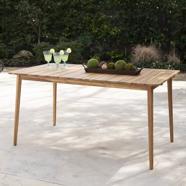 Ila Solid Wood Dining Table by Bay Isle Home