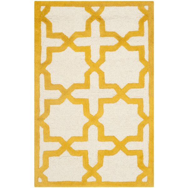 Martins Ivory/Gold Area Rug by Wrought Studio