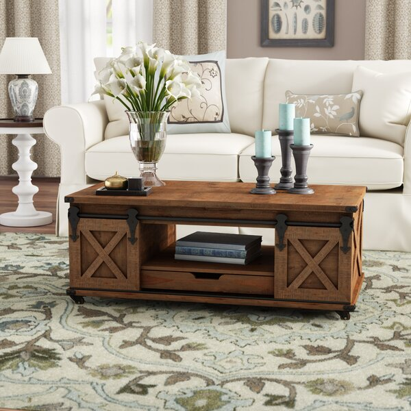 Magnus Solid Wood Wheel Coffee Table With Storage By Gracie Oaks