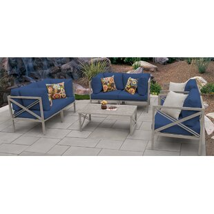 Carlisle Outdoor 7 Piece Sofa Seating Group with Cushions by TK Classics