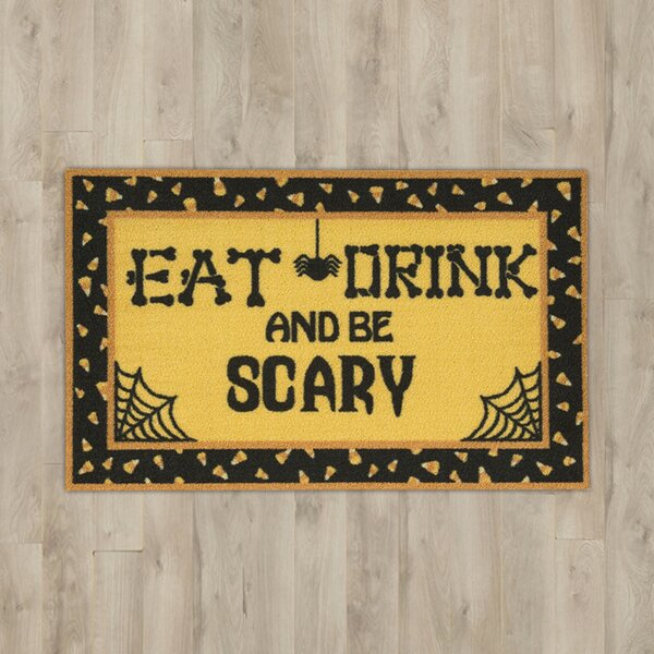 Eat, Drink & Be Scary Yellow Area Rug by The Holid