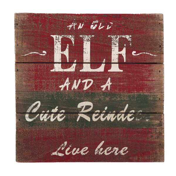 An Old Elf and a Cute Reindeer Live Here Christmas