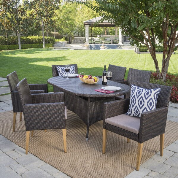 Lonnie Outdoor Wicker Rectangular 7 Piece Dining Set with Cushions by Mistana